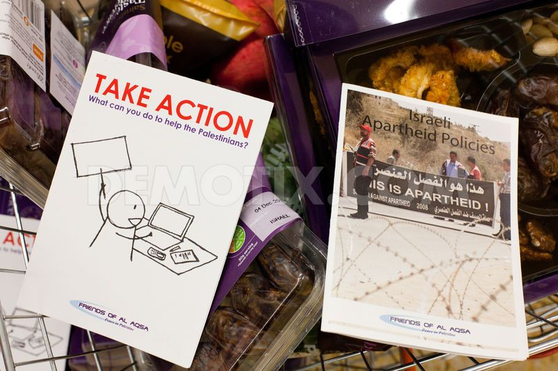 Human rights activists arranged flyers detailing Israeli human rights abuses in baskets of Sainsbury's Israeli products.