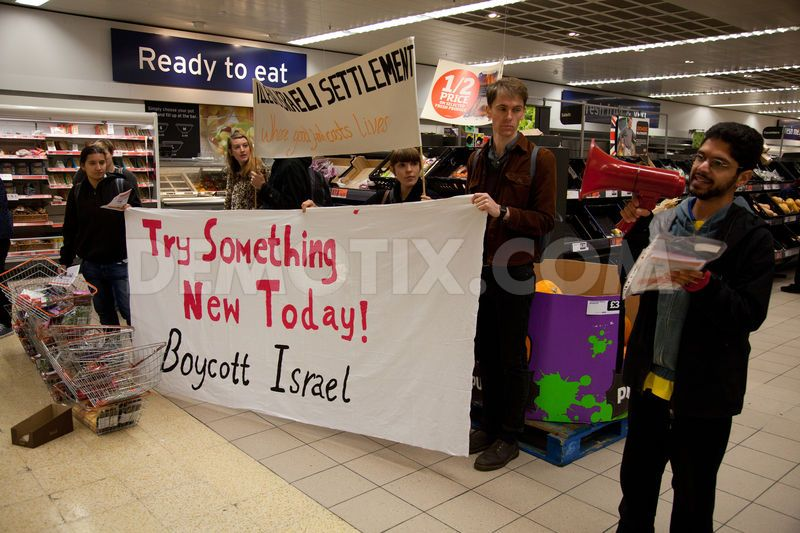 Human rights activists used loud hailers to explain to shoppers that Sainsbury's, unlike the Co-operative supermarket, stocks products from Israeli settlements in the occupied West Bank considered illegal under international law.