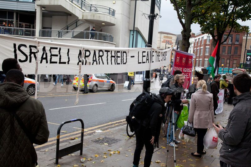 Human rights activists display a banner stating 'Israeli Apartheid - Leave The Shop' outside the large Sainsbury's supermarket in Islington, London.
