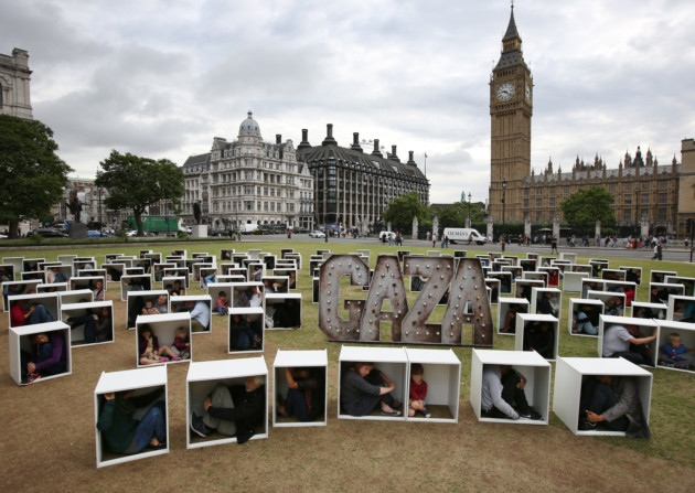 150 people squeeze into tiny boxes opposite Parliament to protest Gaza blockade