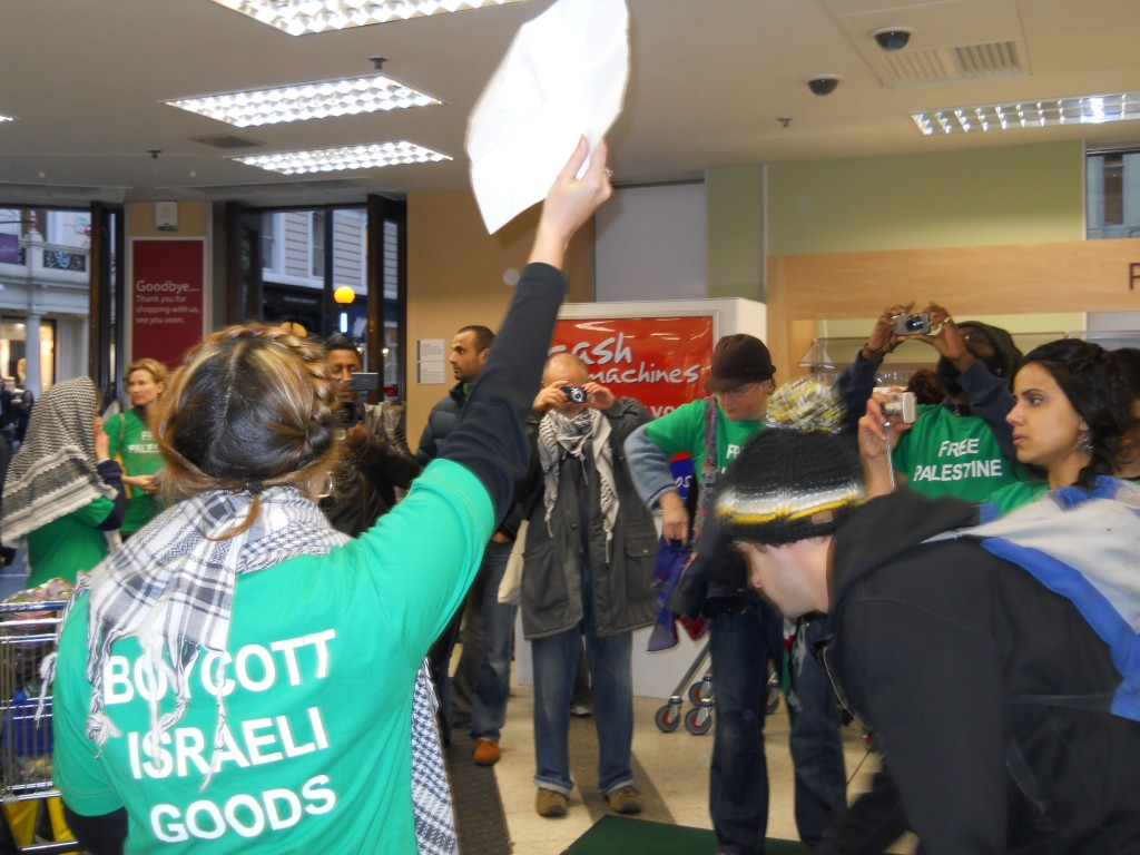 Activists wore green T-shirts that read BOYCOTT ISRAELI GOODS and FREE PALESTINE.